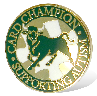 "Gold pin with USF Bull that reads ""CARD Champion Supporting Autism"""